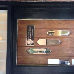 New bronze front door plates - each property