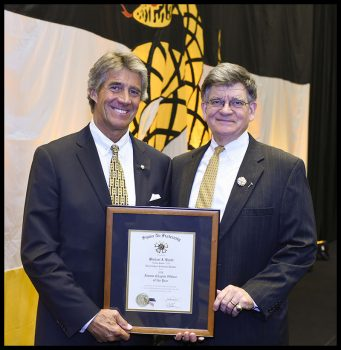 Michael receiving his award from Regent Lee Perrett